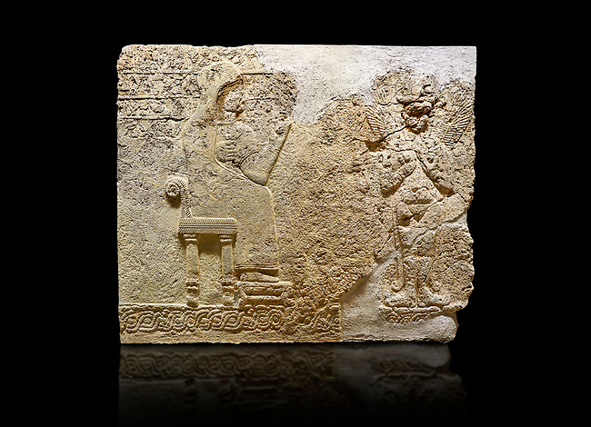"Hittite relief sculpted orthostat stone panel  of Long Wall Limestone, Karkamıs, (Kargamıs), Carchemish (Karkemish), 900-700 BC. Anatolian Civilisations Museum.<br /> <br />  The hieroglyphics reads; ""I am Win-a-tis, beloved wife of my Lord Suhi, wherever and whenever my husband honours his name, he will honour my name as well with favours"". Underneath, there are two goddess figures, one is naked with a horned head, holding her breasts with her hands. Her genitalia is indicated by a triangle. <br /> <br /> On a black background."