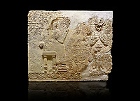 Hittite relief sculpted orthostat stone panel  of Long Wall Limestone, Karkamıs, (Kargamıs), Carchemish (Karkemish), 900-700 BC. Anatolian Civilisations Museum.<br /> <br />  The hieroglyphics reads; &quot;I am Win-a-tis, beloved wife of my Lord Suhi, wherever and whenever my husband honours his name, he will honour my name as well with favours&quot;. Underneath, there are two goddess figures, one is naked with a horned head, holding her breasts with her hands. Her genitalia is indicated by a triangle. <br /> <br /> On a black background.