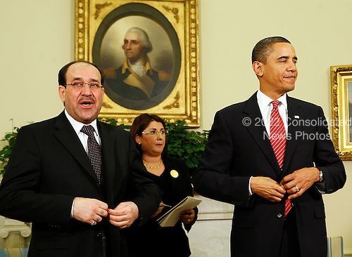 Washington, DC - October 20, 2009 -- United States President Barack Obama (R) meets with Prime Minister Nouri Al-Maliki of Iraq (L) in the Oval Office of the White House, Washington, DC, Tuesday, October 20, 2009..Credit: Aude Guerrucci / Pool via CNP