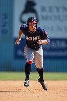 Braxton Davidson (24) of the Rome Braves hustles towards third base against the Asheville Tourists at McCormick Field on July 26, 2015 in Asheville, North Carolina.  The Tourists defeated the Braves 16-4.  (Brian Westerholt/Four Seam Images)