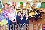 CHANGING TIMES: Parents of children from Aughcasla National School are delighted to have a school uniform introduced this year for the very first time. PIctured were Ann Connell, Frances McGaley, Christina O'Shea and Shirley O'Brien with children Gavin O'Brien, Aoife O'Connell, Lenny McGaley, Clare McCormack, Sadhbh Hanley and Aodh Connell.