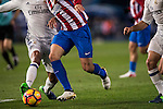 Fernando Torres of Atletico de Madrid battles for the ball with Raphael Varane of Real Madrid during their La Liga match between Atletico de Madrid and Real Madrid at the Vicente Calderón Stadium on 19 November 2016 in Madrid, Spain. Photo by Diego Gonzalez Souto / Power Sport Images