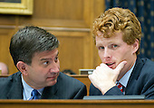 """United States Representatives Brad Schneider (Democrat of Illinois), left, and Joseph P. Kennedy III (Democrat of Massachusetts), right, discuss the testimony of U.S. Secretary of State John Kerry before the U.S. House Committee on Foreign Affairs about the President's recently announced strategy on ISIS in Washington, D.C. on Thursday, September 18, 2014.  The hearing is entitled """"The ISIS Threat:  Weighing the Obama Administration's Response."""" <br /> Credit: Ron Sachs / CNP"""