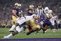 Myles Gaskin gets hammered, but scores his third touchdown on a pass from Jake Browning to end the first half.
