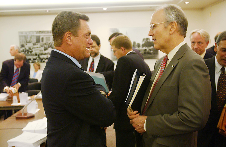 11/5/03.FISCAL 2004 APPROPRIATIONS: ENERGY AND WATER DEVELOPMENT--Michael K. Simpson, R-Idaho, and Sen. Larry E. Craig, R-Idaho, talk before the meeting of House and Senate conferees to consider legislation that would make fiscal 2004 appropriations for energy and water development programs. .CONGRESSIONAL QUARTERLY PHOTO BY SCOTT J. FERRELL