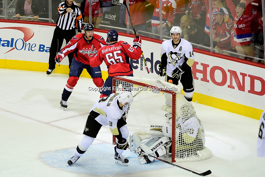 Thursday, April 28, 2016: Washington Capitals left wing Andre Burakovsky (65) celebrates a first period goal with left wing Jason Chimera (25) as Pittsburgh Penguins goalie Matt Murray (30) sits in the net during the NHL Eastern Conference playoffs between the Pittsburgh Penguins and the Washington Capitals held at the Verizon Center in Washington DC. Eric Canha/CSM