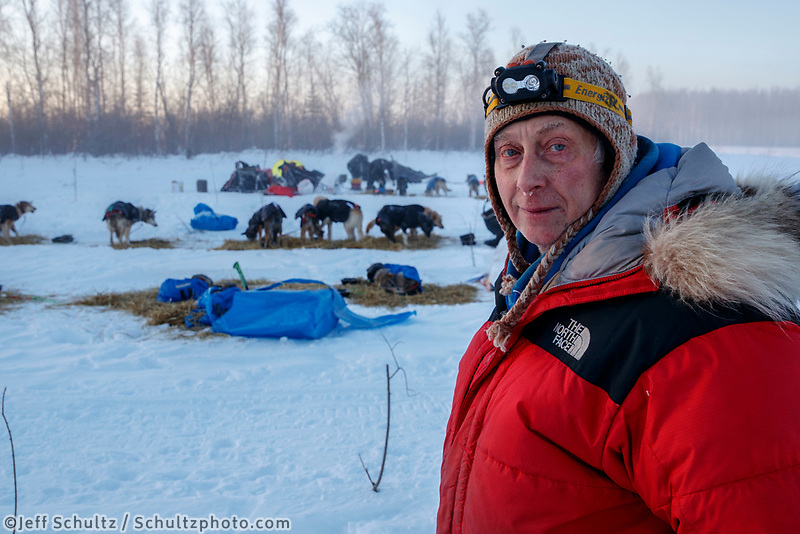 Joe Redington, son of the Father of the Iditarod Joe Redington Sr. looks over the dog lot that he was the lead in organizing at the checkpoint in Manley Hot Springs during the 2017 Iditarod on Tuesday March 7, 2017.<br /> <br /> Photo by Jeff Schultz/SchultzPhoto.com  (C) 2017  ALL RIGHTS RESVERVED