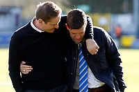 AFC Wimbledon manager, Neal Ardley and Bristol Rovers manager, Darrell Clarke embrace during the Sky Bet League 1 match between AFC Wimbledon and Bristol Rovers at the Cherry Red Records Stadium, Kingston, England on 17 February 2018. Photo by Carlton Myrie.