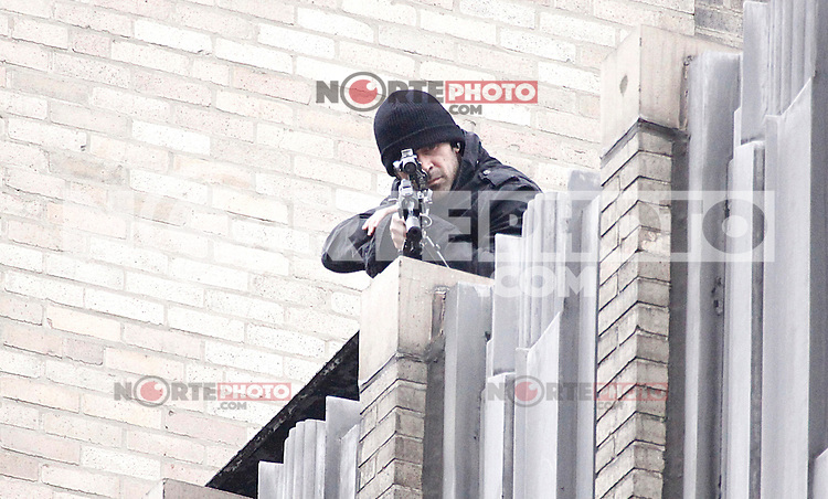 Colin Farrell pictured 10 stories up on a roof during filming of Dead Man Down on Walnut Street in Philadelphia, Pa on May 3, 2012  © Star Shooter / MediaPunchInc