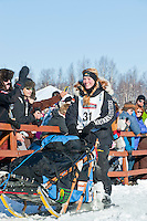 Iditarod musher Kristy Berington leaves the gate at the Restart of Iditarod 2012, Willow, Alaska, March 4, 2012
