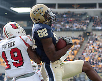 Pitt wide receiver Jon Baldwin was unable to stay inbounds on this catch. Defending is Louisville defensive back Johnny Patrick. The Pitt Panthers defeated the Louisville Cardinals 20-3 at Heinz Field, Pittsburgh Pennsylvania on October 30, 2010.