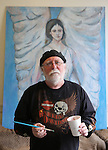 Cliff Brown poses in front of and angel he recently painted at his studio/office in the Majestic Building earlier this week. Brown recently completed college and said he likes visiting the galleries, museums and coffee shops around Cheyenne. To participate in WTE Photo Editor Michael Smith's Our Faces: Portraits of Laramie County project, call 633-3124 or 630-8388 or email msmith@wyomingnews.com to make an appointment. To see all of the portraits published so far, go online to ourfaces.wyomingnews.com. Michael Smith/staff