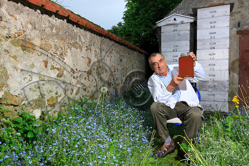 """Jean Paucton, at his home in Coignières in the Yvelines. """"I sometimes harvest over 100 kilos of honey per hive in Paris for less than 20 in Coignières or in the Creuse. I presently have five hives on the opera. I harvest little by little, frame by frame, the passage to get on to the roof is narrow. As a rule, I go on Sundays""""."""