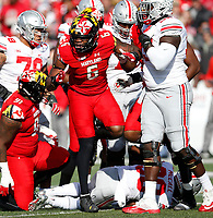 Maryland Terrapins defensive lineman Jesse Aniebonam (6) celebrates his tackle of Ohio State Buckeyes running back Demario McCall (30) in the first half of their game at Maryland Stadium in College Park, MD on November 17, 2018. [ Brooke LaValley / Dispatch ]