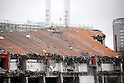 Workers remove the stands from Tokyo's National Stadium on April 7, 2015 in Tokyo, Japan. The National Stadium was used as the main venue for the 1964 Tokyo Olympics and is scheduled to be replaced by a new 80,000 capacity stadium designed by Zaha Hadid in time for the 2019 Rugby World Cup and the 2020 Summer Olympic Games. The whole project is expected to cost over 170 billion Yen. (Photo by Rodrigo Reyes Marin/AFLO)