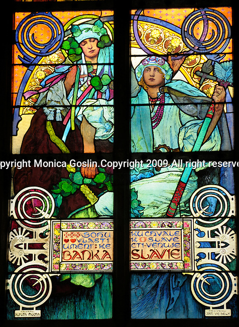 Stainglass window by Mucha in the St Vitus Cathedral at the Prague Castle at in Prague, Czech Republic.