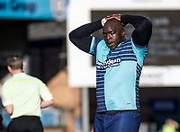A dejected looking Adebayo Akinfenwa of Wycombe Wanderers during the Sky Bet League 2 match between Wycombe Wanderers and Notts County at Adams Park, High Wycombe, England on the 25th March 2017. Photo by Liam McAvoy.