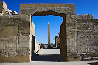 Obelisk of Thutmose I framed by doorway covered in hierglyphs, Temple of Karnak located in modern day Luxor or ancient Thebes, Egypt.