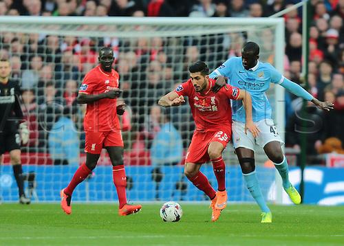 28.02.2016. Wembley Stadium, London, England. Capital One Cup Final. Manchester City versus Liverpool. Manchester City Midfielder Yaya Touré puts pressure on Liverpool Midfielder Emre Can