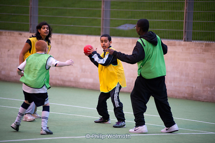 Handball game at an after-school club at the Winchester Project, Swiss Cottage, which is threatened with closure following government cuts to Camden Council's funding.