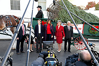 First lady Melania Trump and son Barron pose with the Chapman family of Silent Night Evergreens as they accept the White House Christmas tree on the North Portico of the White House in Washington, DC on Monday, November 20, 2017.  The tree will stand in the Blue Room.<br /> Credit: Ron Sachs / CNP /MediaPunch /NortePhoto.com