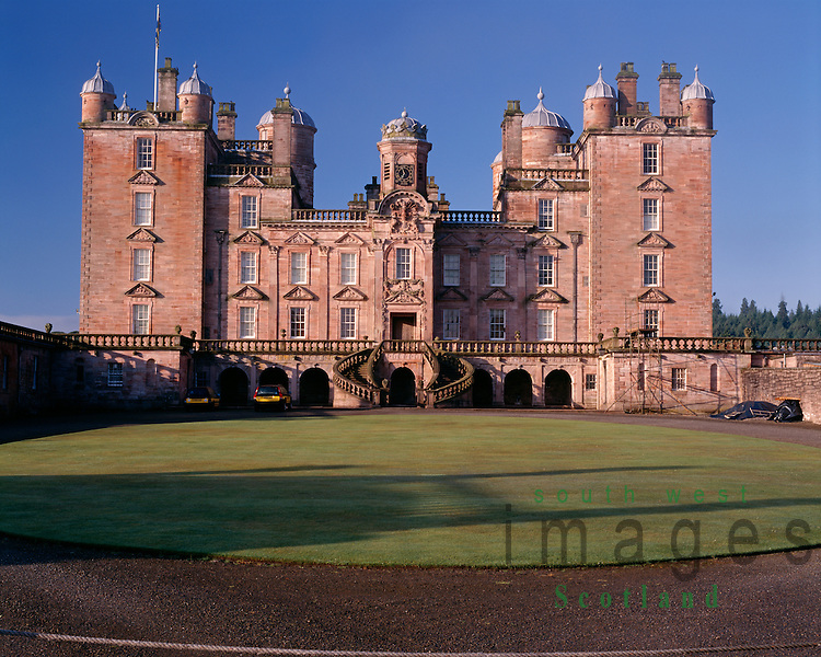 The stately home of the Duke of Queensberry, the rear of Drumlanrig Castle fine renaissance architecture in pink sandstone Nithsdale Dumfries and Galloway Scotland UK