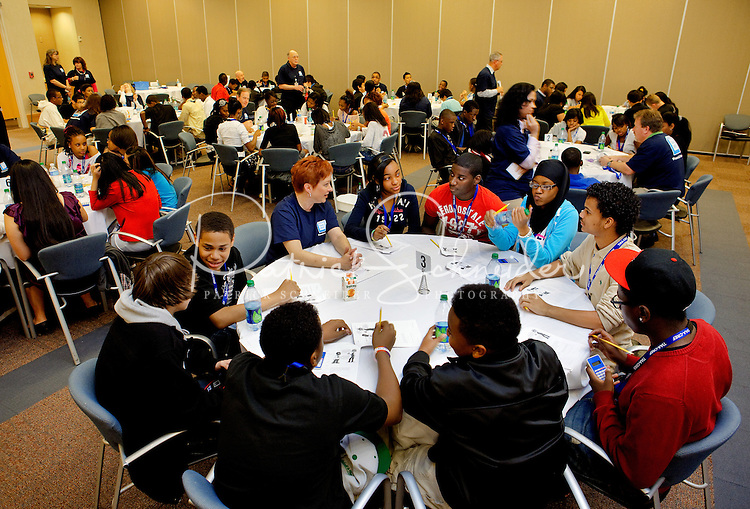"TIAA-CREF - is celebrating National Financial Literacy month by hosting "" financial literacy in a day"" event in Charlotte, NC. TIAA employee volunteers are teaching 400 Eighth students from Ranson Middle School and Martin Middle School over a three-day period."