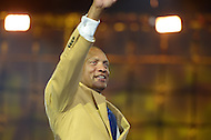 Canton, Ohio - August 1, 2014: Aeneas Williams waves to the audience after donning his gold jacket during the Pro Football Hall of Fame's class of 2014 enshrinement dinner in Canton, Ohio  August 1, 2014. During his career, Williams had nine interceptions returned for a touchdown and was named to eight Pro Bowl teams.  (Photo by Don Baxter/Media Images International)