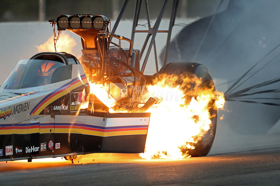 Nov 10, 2018; Pomona, CA, USA; NHRA top fuel driver Mike Salinas suffers an engine fire in his dragster during qualifying for the Auto Club Finals at Auto Club Raceway. Mandatory Credit: Mark J. Rebilas-USA TODAY Sports