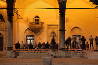 Men praying in the courtyard of the Gazi Husrev-beg Mosque, built 1530-32, Sarajevo, Bosnia and Herzegovina. The complex includes a maktab and madrasa (Islamic primary and secondary schools), a bezistan (vaulted marketplace)and a hammam. The mosque was renovated after damage during the 1992 Siege of Sarajevo during the Yugoslav War. Picture by Manuel Cohen