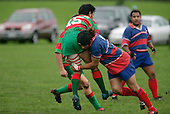 Waiuku's O. Latatasi is hit in a strong tackle from Ardmore Marist flanker S. Te Tamaki. Counties Manukau Premier Club Rugby, Ardmore Marist vs Waiuku played at Bruce Pulman Park, Papakura on the 29th of April 2006. Ardmore Marist won 10 - 9.