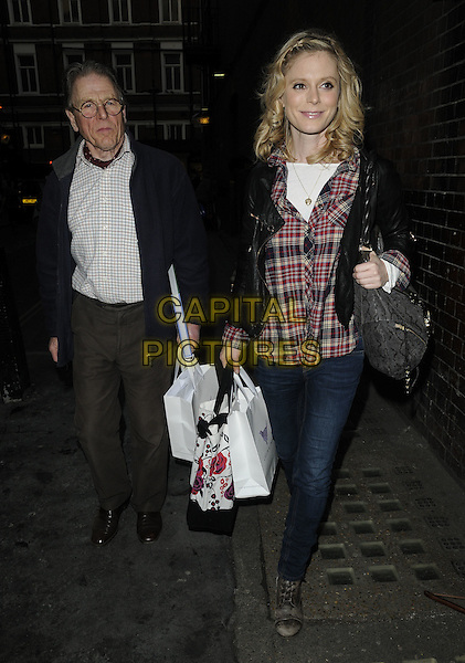 "EDWARD FOX & EMILIA FOX .""We Are One: A Celebration of Tribal People"" Fundraiser, Apollo Theatre, London, England, UK, April 18th 2010..full length family  black leather jacket plaid checked check red shirt jeans bag daughter father dad walking bags .CAP/CAN.©Can Nguyen/Capital Pictures."