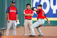 "July 28, 2009:  Starting Pitcher Junichi Tazawa of the Pawtucket Red Sox delivers a pitch in the bullpen as his interpreter and pitching coach Rich Sauver watch before a game at Coca-Cola Field in Buffalo, NY.  Tazawa was signed out of Japan and making his ""AAA"" debut with Pawtucket, the International League Triple-A affiliate of the Boston Red Sox.  Photo By Mike Janes/Four Seam Images"