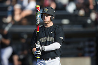 Jonathan Pryor (11) of the Wake Forest Demon Deacons checks his bat before stepping up to the plate against the Florida State Seminoles at David F. Couch Ballpark on April 16, 2016 in Winston-Salem, North Carolina.  The Seminoles defeated the Demon Deacons 13-8.  (Brian Westerholt/Four Seam Images)