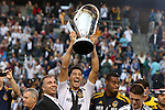 01 December 2012: Los Angeles' Omar Gonzalez, with head coach Bruce Arena (left), holds the Philip F. Anschutz Trophy overhead. The Los Angeles Galaxy played the Houston Dynamo at the Home Depot Center in Carson, California in MLS Cup 2012. Los Angeles won the game 3-1.