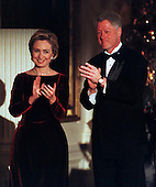 """United  States President Bill Clinton and first lady Hillary Rodham Clinton applaud the recipients of the """"1998 Kennedy Center Honors"""" during a ceremony in the East Room of the White House in Washington, D.C. on December 6, 1998..Credit: Ron Sachs - CNP"""