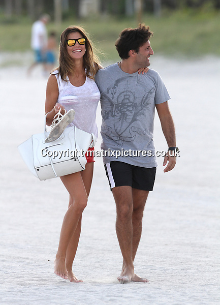 NON EXCLUSIVE PICTURE: MATRIXPICTURES.CO.UK.PLEASE CREDIT ALL USES..UK, AUSTRALIA, NEW ZEALAND AND ASIA RIGHTS ONLY..Paraguayan-Italian model Claudia Galanti is pictured enjoying a relaxing Christmas day with her boyfriend Arnaud Mimran on Miami Beach...DECEMBER 25th 2012..REF: KDA 126121..XIM