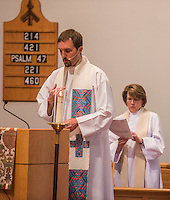 NWA Democrat-Gazette/ANTHONY REYES &bull; @NWATONYR<br /> Rev. Clint Schnekloth, pastor at Good Shepherd ECLA Church in Fayetteville, leads a prayer Thursday, May 14, 2015 as Rev. Pamela Morgan, rector at St. Thomas Episcopal Church, follows along during the Ascension Day service at St. Thomas Episcopal in Springdale. The church held a joint worship service with Good Shepherd and other local churches.