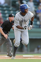 First baseman Correlle Prime (32) of the Asheville Tourists bats in a game against the Greenville Drive on Tuesday, July 1, 2014, at Fluor Field at the West End in Greenville, South Carolina. Asheville won, 5-2. (Tom Priddy/Four Seam Images)