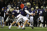 Jake Locker (#10), University of Washington quarterback, prepares to hand off during the Huskies Pac-10 conference football game against arch-rival Washington State at Husky Stadium in Seattle, Washington, on November 28, 2009.  Washington shut out the Cougars in their annual Apple Cup battle, 30-0.