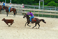 Girl on horseback in a rodeo calf-roping contest, Waimanalo, O'ahu