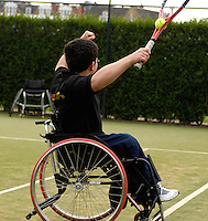 Queens Club, GREAT BRITAIN,   Wheel chair Tennis, Jon SMITH, celebrates after trapping the ball in the neck/handle of the racket,  before the  press Conference to announce the joint initiative between British Paralympic Association and Deloitte  of 'www.Parasport.org.uk' online information service, on Thur's.  03.05.2007. London. [Credit: Peter Spurrier/Intersport Images]