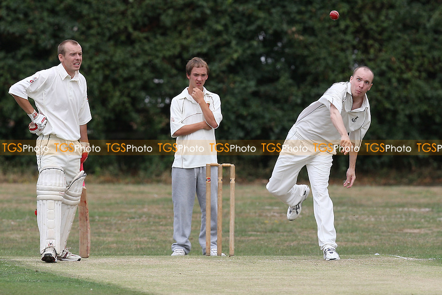 L Sutton in bowling action for Upminster - Upminster CC 4th XI vs Wickford CC 3rd XI - Essex Cricket League - 07/08/10 - MANDATORY CREDIT: Gavin Ellis/TGSPHOTO - Self billing applies where appropriate - Tel: 0845 094 6026