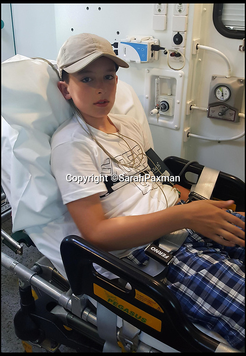 BNPS.co.uk (01202 558833)Pic: SarahPaxman/BNPS<br /> <br /> Lewis in the ICU at Poole hospital.<br /> <br /> A mother told today how her 10-year-old son ended up in intensive care after being bitten by a snake.<br /> <br /> Lewis Paxman was holidaying with family on the Isle of Purbeck in Dorset when a venomous adder slithered out of undergrowth and bit him on the left foot.<br /> <br /> The bite led his left leg to dramatically swell up and caused him to be sick.<br /> <br /> Lewis was rushed to hospital by ambulance where he was given anti-venom, painkillers and antibiotics admitted to intensive care.<br /> <br /> He spent five nights in hospital and even when he was released the swelling was still so severe he had use a wheelchair.
