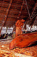 EDITORIAL ONLY. Demonstration of canoe carving and building at Pu'uhonua o Honaunau National Park, South Kona, Big Island