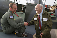 Eskil Amdal (right) and Rolf Kolling sjhake hands after a flight over Kjeller. Norwegian Spitfire Foundation invited Norwegian WWII  Spitfire veterans to fly in Spitfire, at the historical airfield Kjeller in Norway. Front seat pilot was Eskil Amdal, currently the lead fast-jet pilot in the RNoAF with responsibility for the F-16 and F-35.