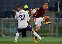 Calcio, Serie A: Roma vs Fiorentina. Roma, stadio Olimpico, 4 marzo 2016.<br /> Roma&rsquo;s Lucas Digne, right, is challenged by Fiorentina&rsquo;s Facundo Roncaglia during the Italian Serie A football match between Roma and Fiorentina at Rome's Olympic stadium, 4 March 2016.<br /> UPDATE IMAGES PRESS/Riccardo De Luca