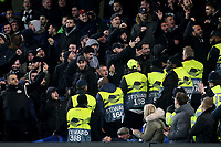 PAOK Salonika supporters taunt the Chelsea fans as the stewards keep them apart during Chelsea vs PAOK Salonika, UEFA Europa League Football at Stamford Bridge on 29th November 2018