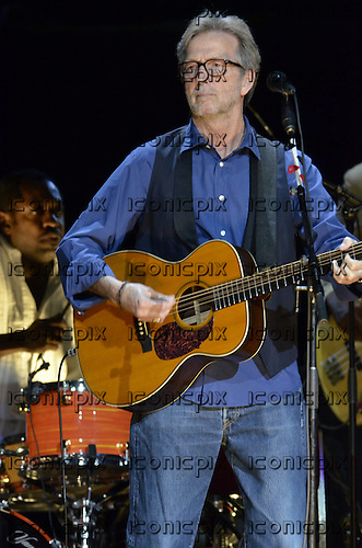 Eric Clapton - performing live on the '50 Years Further On Up The Road Tour' at the Royal Albert Hall in London UK - 17 May 2013.  Photo credit: George Chin/IconicPix