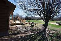 NWA Democrat-Gazette/J.T. WAMPLER  A crew from A-1-Acoustics works Monday March 5, 2018 to build a deck on the back of a house owned by the Springdale Parks Department at J.B. Hunt Park. The house, located at 2315 Lewis Ave., will be the home of Dynamic Discs Northwest Arkansas with a grand opening scheduled for April 21. The disc golf shop with be the fourth of its kind nationally with a planned disc golf driving range,, junior course and eventually a new 18-hole championship level course.